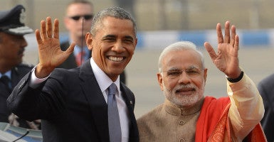Prime Minister Narendra Modi with visiting US President Barack Obama waves upon his  arrival in New Delhi (Photo: Shekhar Yadav/India Today Group/Newscom)