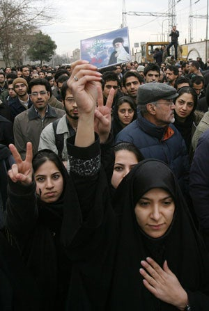 Iranian mourners during funeral for Massoud Ali Mohammadi