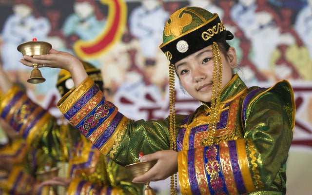 Traditional Mongolian costume. (Photo: Tom Salyer/Stock Connection Worldwide/Newscom)