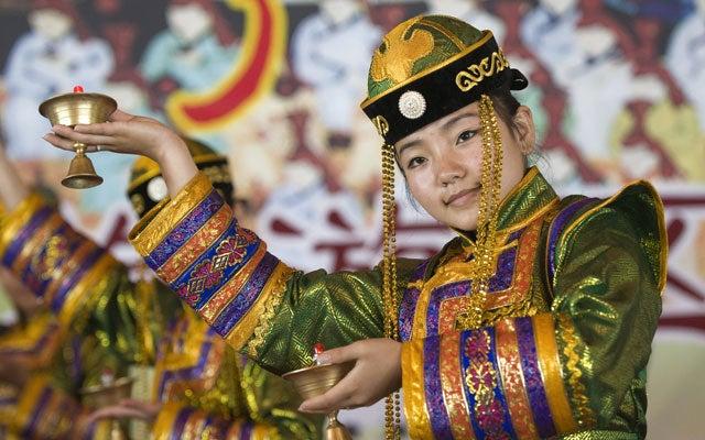 Traditional Mongolian costume. (Photo: Tom Salyer/Stock Connection Worldwide/Newscom)