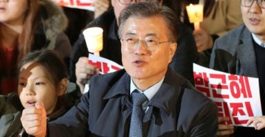 Moon Jae-in, former leader of South Korea's main opposition Democratic Party and a presidential hopeful, participates in a candlelight rally calling on President Park Geun-hye to step down. (Photo: Yonhap News/YNA/Newscom)