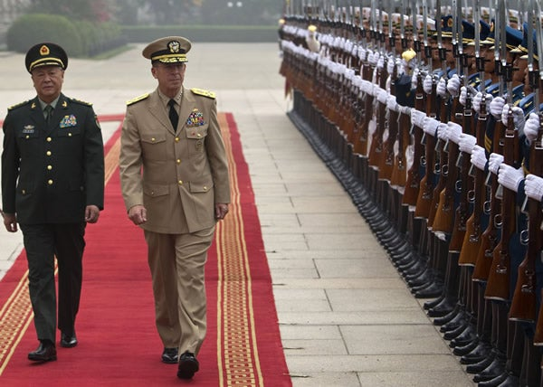 General Chen Bingde (L), chief of the General Staff of the Chinese People's Liberation Army, and US Admiral Mike Mullen (R), chairman of the Joint Chiefs of Staff, review an honor guard in Beijing, China.