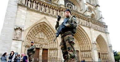 Soldiers patrol in front of the Notre Dame Cathedral in Paris as security increases after last Friday's series of deadly attacks. (Photo: Charles Platiu/Reuters/Newscom)