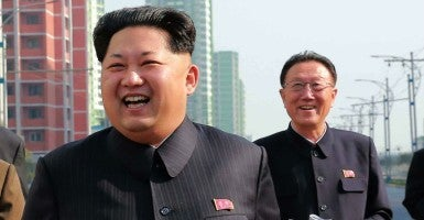 Kim Yang-gon with North Korean leader Kim Jong-un (Photo: Yonhap News/YNA/Newscom)