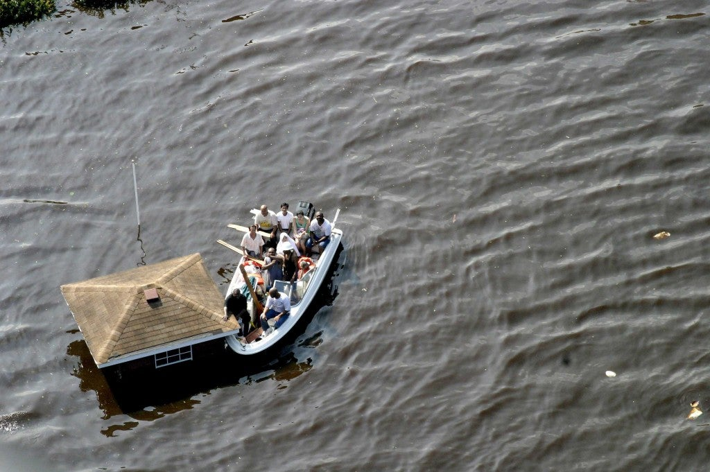 Flood victims in the 9th ward are rescued by a US Coast Guard helicopter. The Coast Guard saved 34,000 people in the city of New Orleans alone. (Photo: Bartlett/SIPA/Newscom)