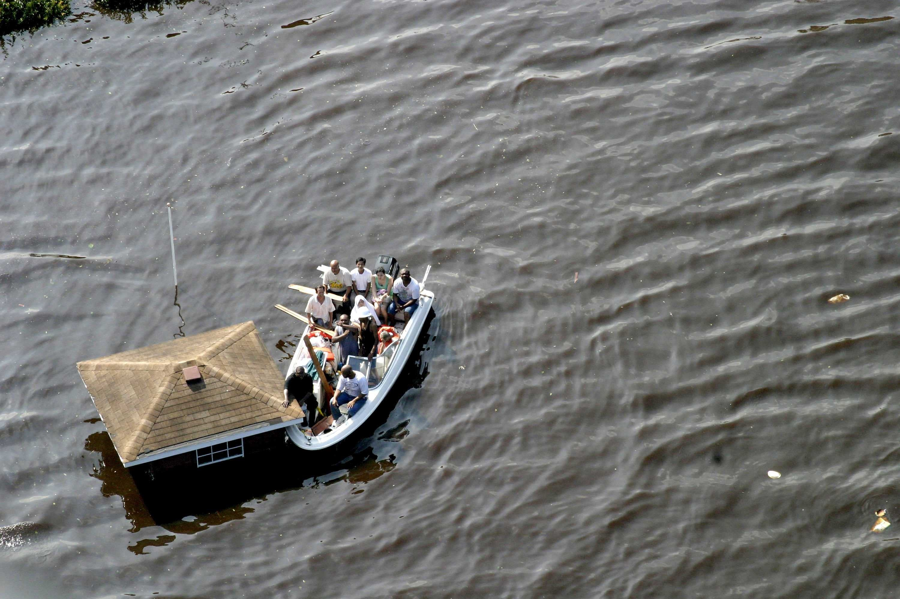 flood victims in the 9th ward are rescued by a us coast guard helicopter the