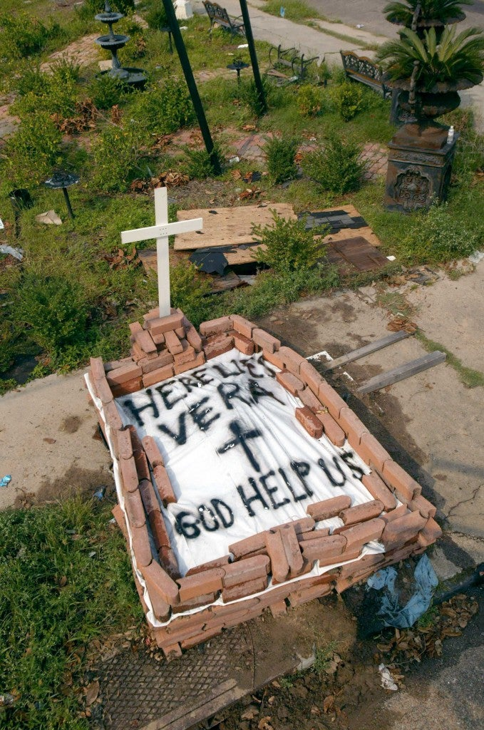A makeshift grave was made during the aftermath of Hurricane Katrina. 1,836 people died due to the catastrophic storm. (Photo: Haley/SIPA/Newscom)