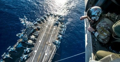USS Ronald Reagan and its embarked air wing, Carrier Air Wing (CVW) 5, provide a combat-ready force that protects and defends the collective maritime interests of the U.S. and its allies and partners in the Indo-Asia-Pacific region. (Photo: U.S. Navy Specialist 2nd Class Paolo Bayas)