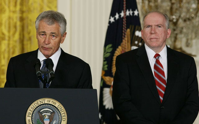 Chuck Hagel (L) and John Brennan. (Photo: Fang Zhe/Xinhua/Photoshot/Newscom)