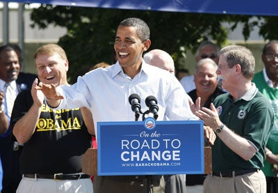 Teamsters General President James Hoffa, left, UAW President Ron Gettelfinger, flank President Barack Obama