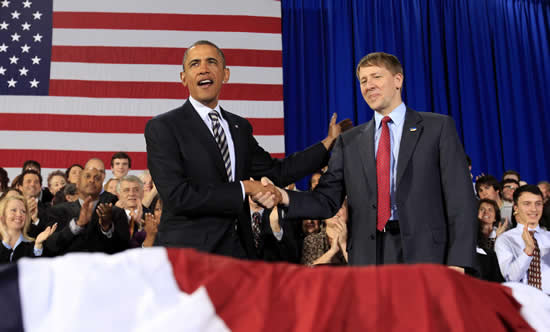 U.S. President Barack Obama shakes hands with his recess appointee Richard Cordray (R) as head of the country's new consumer financial protection watchdog, sidestepping Republican congressional opposition to his pick during a trip to Cleveland, Ohio January 4, 2011. The Consumer Financial Protection Bureau was created by the 2010 Dodd-Frank financial oversight law to police the market for consumer products such as credit cards and mortgages. REUTERS/Kevin Lamarque
