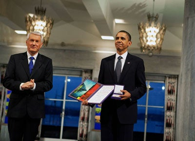 Nobel Committee Chairman Thorbjorn Jagland presents U.S. President Barack Obama with the Nobel Prize medal