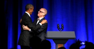 U.S. President Barack Obama embraces Jim Obergefell who introduced him to speak at a Democratic National Committee LGBT Gala at Gotham Hall in New York September 27, 2015. (Photo: KEVIN LAMARQUE/REUTERS/Newscom)