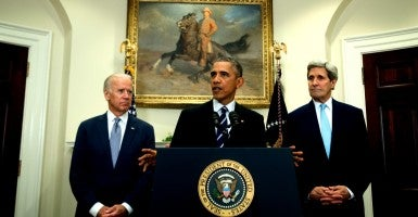 President Barack Obama flanked by Vice President Joe Biden and Secretary of State John Kerry. (Photo: Consolidated News Photos/Newscom)