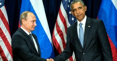 Russia's President Vladimir Putin (L) and US President Barack Obama shake hands at a meeting after the 70th session of the United Nations General Assembly (Photo: Guneyev Sergei/ZUMA Press/Newscom)