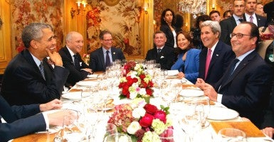 President Barack Obama has dinner in Paris with French President Francois Hollande and others, including U.S. Secretary of State John Kerry, French Ecology Minister Segolene Royal and French Foreign Minister Laurent Fabius.  (Photo: Thibault Camus/Reuters/Newscom)