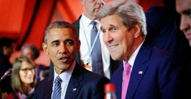 Le Bourget, France - U.S. President Barack Obama talks with Secretary of State John Kerry during the opening plenary session of the COP21, United Nations Climate Change Conference Nov. 30, 2015 (Photo: Arnaud Bouissou/ZUMA Press/Newscom)
