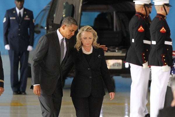 Obama and Hillary Clinton at transfer of remains ceremony