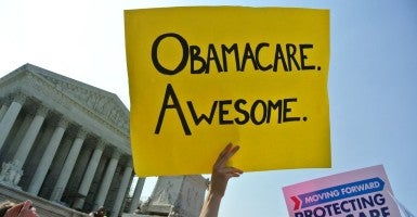 Obamacare poster on the steps of the Supreme Court. (Photo: Will O'Neill / Flickr / CC BY 2.0)