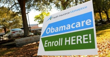 An Obamacare sign is seen outside a health insurance marketplace enrollment center in Orlando, Fla. (Photo: Paul Hennessy/Polaris/Newscom)
