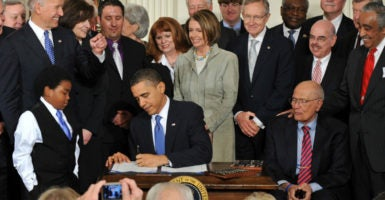 President Barack Obama signed the Affordable Care Act into law in March 2010. (Photo: Kevin Dietsch/UPI/Newscom)