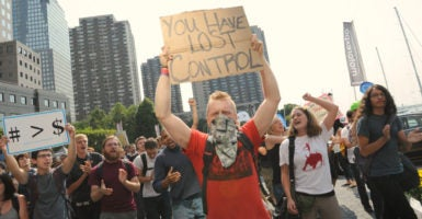 A group of people associated with the Occupy movement protest in New York City on Sept. 17, 2012. (Photo: Stephanie Keith/Polaris/Newscom)