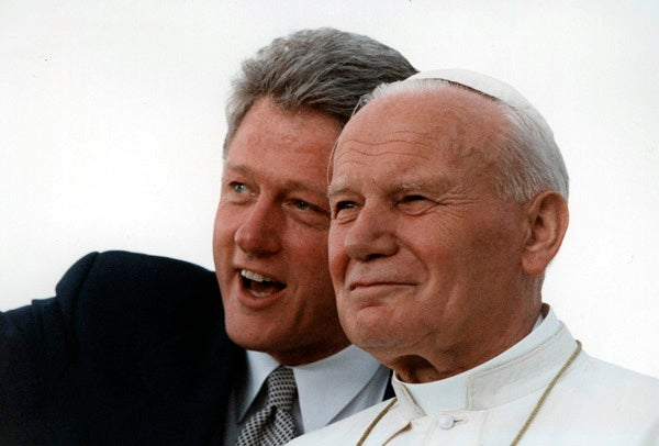During his October visit in 1995, John Paul II visited Newark, NJ, New York (including Brooklyn), and Baltimore. The Clintons greeted him in Newark. In this 1993 photo of Clinton and Pope John Paul II, the pair admires the crowd at Denver's Stapleton International Airport. (Photo: Robert McNeely/National Archives)