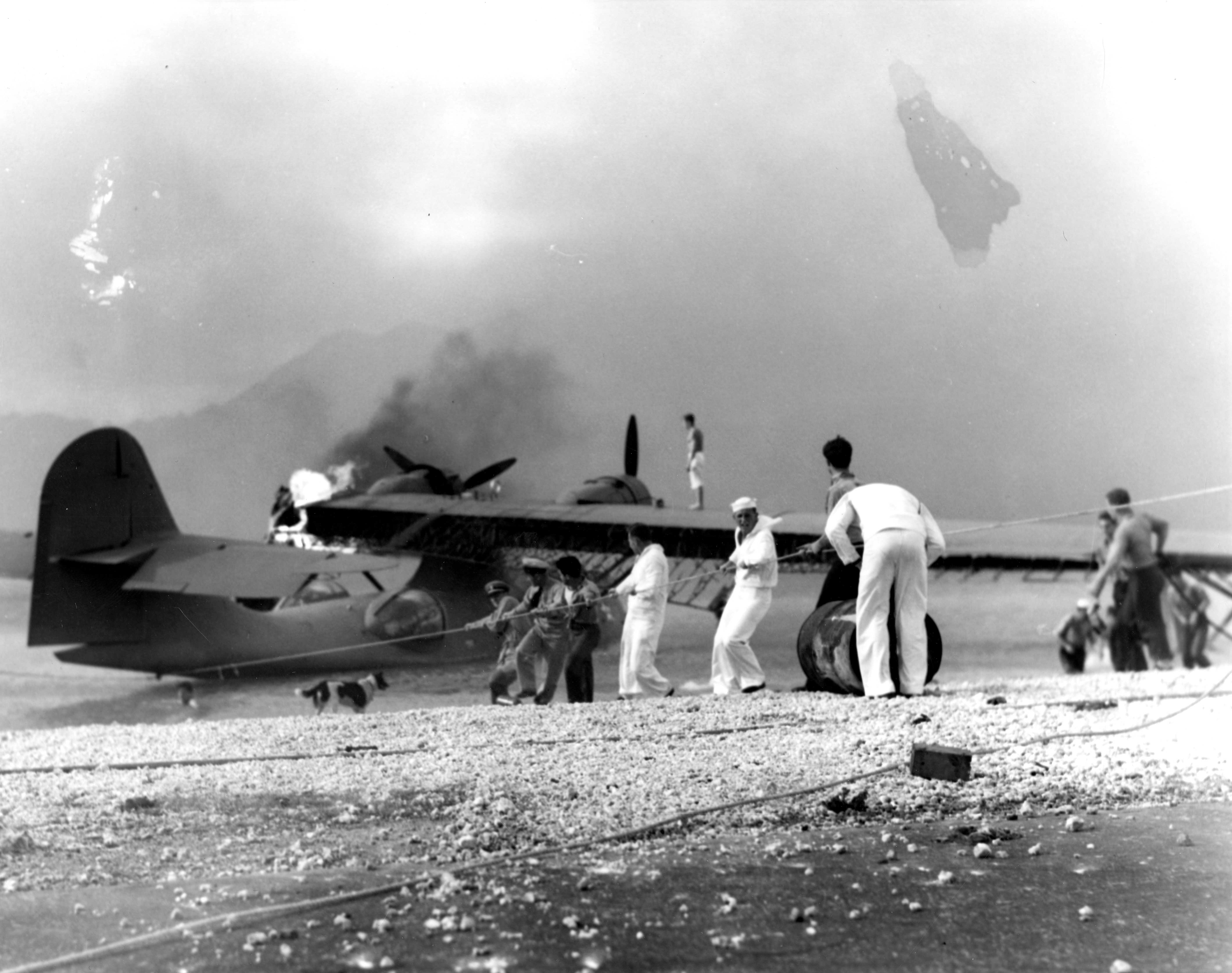 Sailors attempt to save a burning amphibious aircraft at during the Japanese attack on Pearl Harbor. (Photo: Handout/Reuters/Newscom)