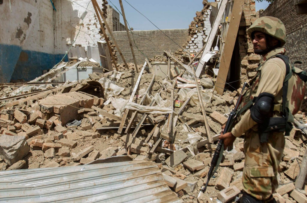 A Pakistani soldier stands near the debris of a house destroyed during a military operation against Taliban militants in Miranshah, North Waziristan, July 9, 2014. (Photo: Stringer/Pakistan/Reuters/Newscom)