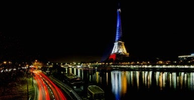 The Eiffel Tower illuminated with the colors of the French flag, in tribute to the victims of the Nov. 13 Paris terror attacks. (Photo: Laruentvu/SIPA/Newscom)