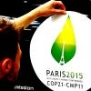 An employee installs a sticker with the logo of the upcoming COP21 Climate Change Conference on a Nissan LEAF electric car in Boulogne-Billancourt, near Paris, France, Nov. 16, 2015 (Photo: Beoit Tessier/Reuters/Newscom)
