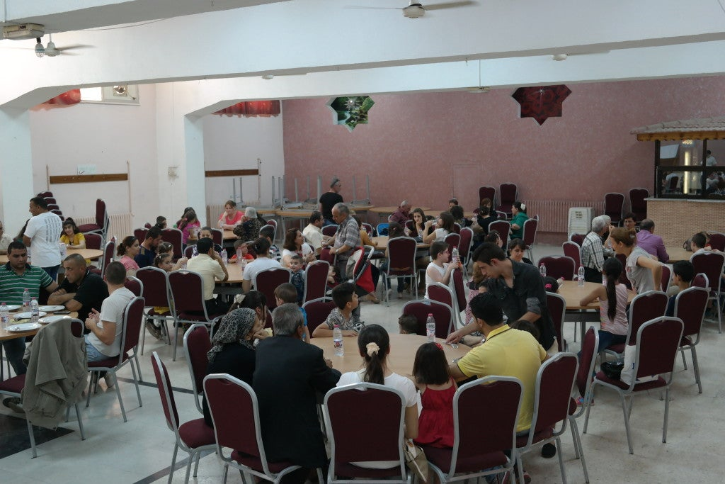 Families gather for a luncheon in St. Mary's parish hall. (Photo: Charlotte Florance/The Daily Signal)