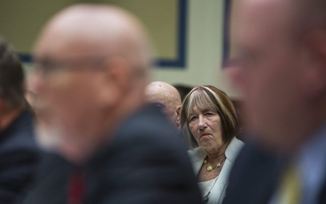 Patricia Smith (C), mother of Sean Smith, a State Department official killed in the terrorist attack in Benghazi, Libya, watches Gregory Hicks (L), foreign service officer and former deputy chief of mission in Libya at the State Department, testify. (Photo: Jim Lo Scalzo/EPA/Newscom)