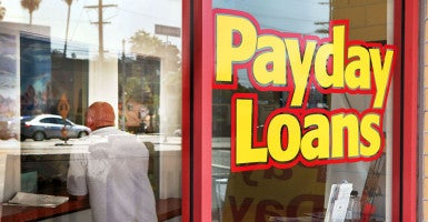 More than 12 million Americans borrow over $7 billion per year from payday lenders. (Photo: CIRO Cesar/LA Opinion/Newscom)