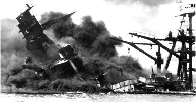 Naval photograph documenting the Japanese attack on Pearl Harbor, Hawaii which initiated US participation in World War II. Navy's caption: The battleship USS ARIZONA sinking after being hit by Japanese air attack on Dec. 7,1941 (Photo: The U.S. National Archives)