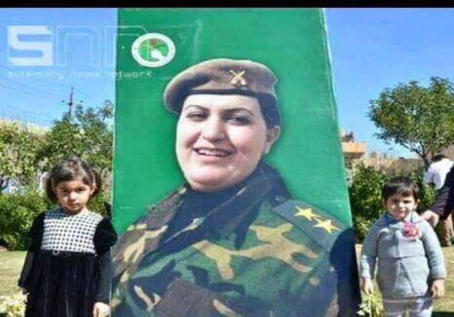 Captain Rengin Yousef, killed in action, and her two children. (Photo courtesy of the 2nd Battalion)
