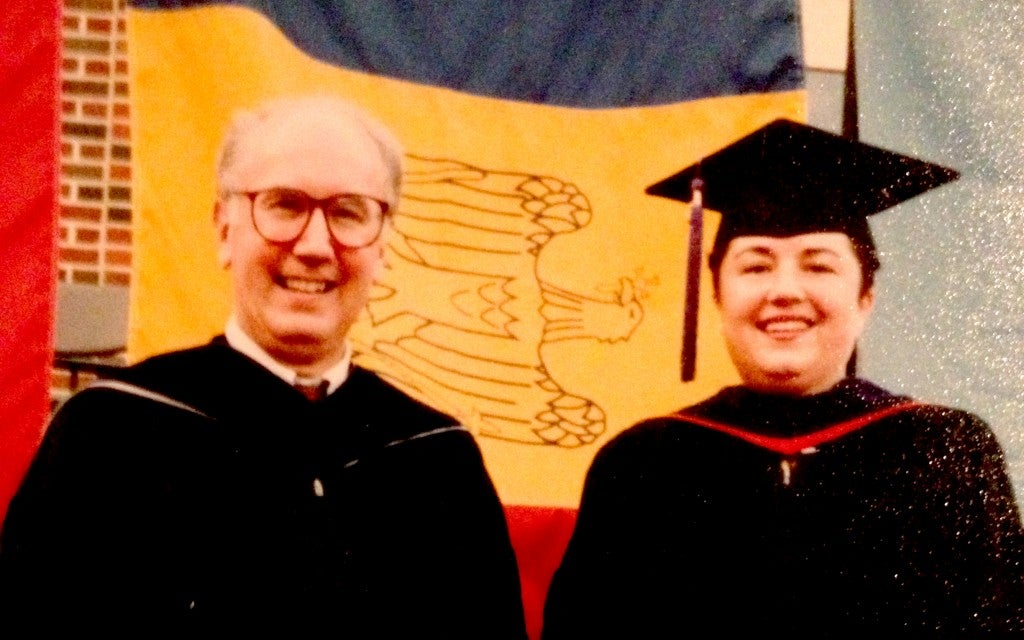 Virginia Prodan and her Southern Methodist University Law School Dean at Prodan's graduation from SMU Law School. The school surprised Prodan with the Romanian flag.