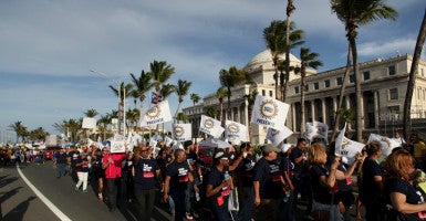 Members of labor unions last year marched past the capitol in San Juan, Puerto Rico against an austerity plan to help the island's debt crisis. (Photo: Alvin Baez/Reuters/Newscom)