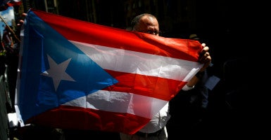 Congress is struggling with how to help Puerto Rico, a U.S. territory that has a $72 billion debt. (Photo: Justin Lane/EPA/Newscom)