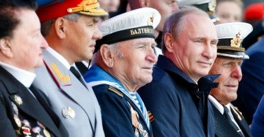 Russia's Defence Minister Sergei Shoigu (2nd L), Russia's President Vladimir Putin (2nd R), and war veterans watch a naval ships parade marking Russian Navy Day (Photo: Nevar Vitaly/ZUMA Press/Newscom)