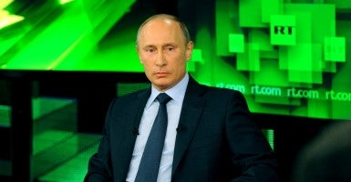 Russia's president Vladimir Putin meets with the team of Russia Today news channel. (Photo: Klimentyev Mikhail TASS/Newscom)