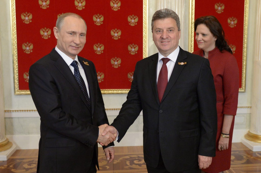 Russian President Vladimir Putin and Macedonian President Gjorge Ivanov shake hands at a meeting in Moscow, Russia, May 9, 2015. (Photo: Nikolsky Alexei/ZUMA Press/Newscom)