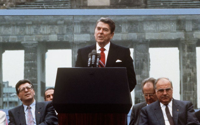 US President Ronald Reagan speaks in front of Brandenburg Gate in Berlin, June 12 1987 (Dieter Klar/picture-alliance / dpa/Newscom)