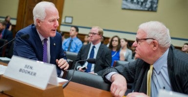 Rep. Jim Sensenbrenner, R-Wis., right, talks with Senate Majority Whip John Cornyn, R-Texas, before a House Oversight and Government Reform Committee hearing in Rayburn Building on criminal justice reform, July 14, 2015. (Photo By Tom Williams/CQ Roll Call/Newscom)
