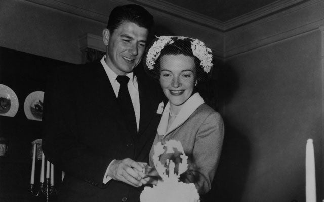 Newlyweds Ronald and Nancy Reagan cutting their wedding cake on March 4, 1952. (Everett Collection/Newscom)