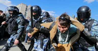 Russian riot policemen detain protesters during an opposition rally in central Moscow, Russia, March 26, 2017. (Photo: Yuri Kochetkov/EPA/Newscom)