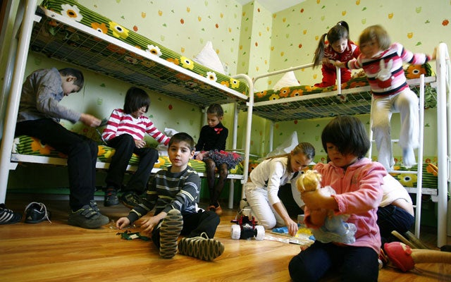 Children play in their bedroom at a Russian orphanage. (Photo: Reuters/Vladimir Konstantinov/Newscom)