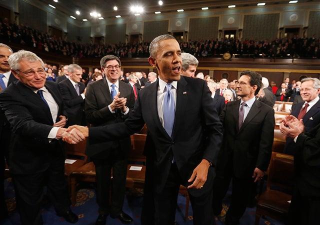 President Barack Obama shakes hands with Defense Secretary Chuck Hagel. (Photo: Newscom)