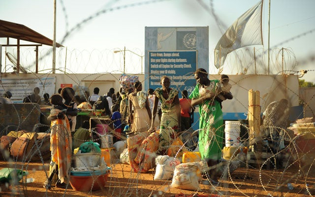 Residents of Juba arrive at the U.N. compound, where they sought shelter. (Photo: TONY KARUMBA/AFP/Getty Images/Newscom)