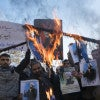Iranian protesters burn U.S. and Israeli flags during a protest against the execution of the Shia cleric Sheikh Nimr al-Nimr. (Photo: Morteza Nikoubazl/SIPA/Newscom)
